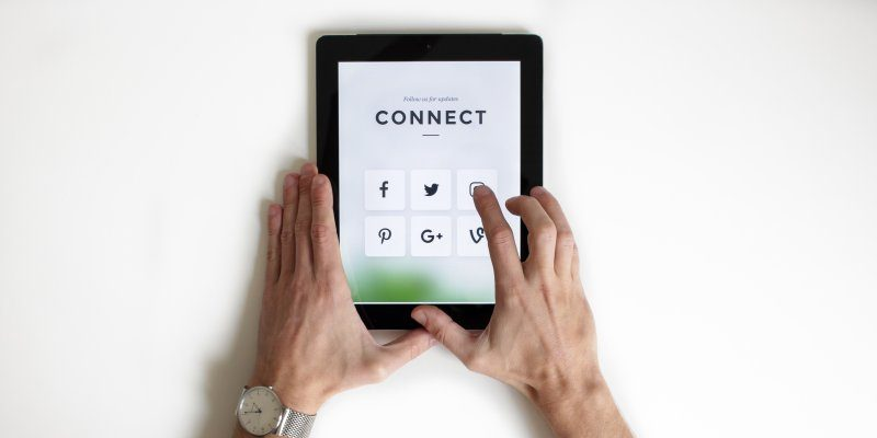 Tablet social media icons with words Connect